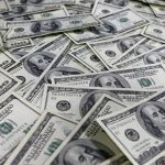 Dollar remains flat versus domestic unit