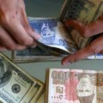 Dollar edges higher in value versus rupee