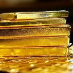 Gold price slips on thin demand, hedging