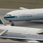 Hong Kong airline Cathay Pacific sees annual loss, outlook upbeat