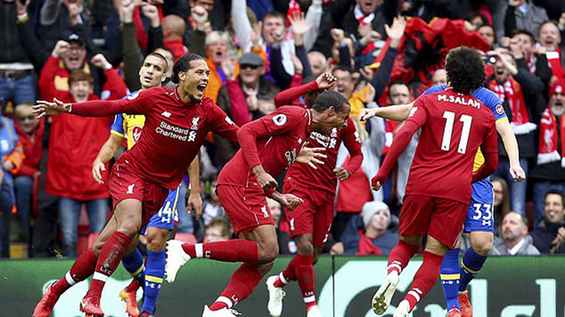 LONDON  Liverpool and Manchester City s shootout for the Premier League  title intensified on Saturday with comfortable wins over Southampton and  Cardiff 4385e44ee