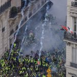 Tear gas, mass arrests as Paris hit by new 'yellow vest' protests