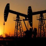 Oil tumbles on increased US output and persisting trade fears