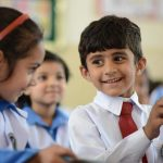 Pakistani children in schools using educational supplies by int'l remittances