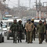 India launches mass arrest drive; sends reinforcements to Kashmir