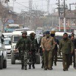 India launches mass arrest drive; sends reinforcements to Kashmir