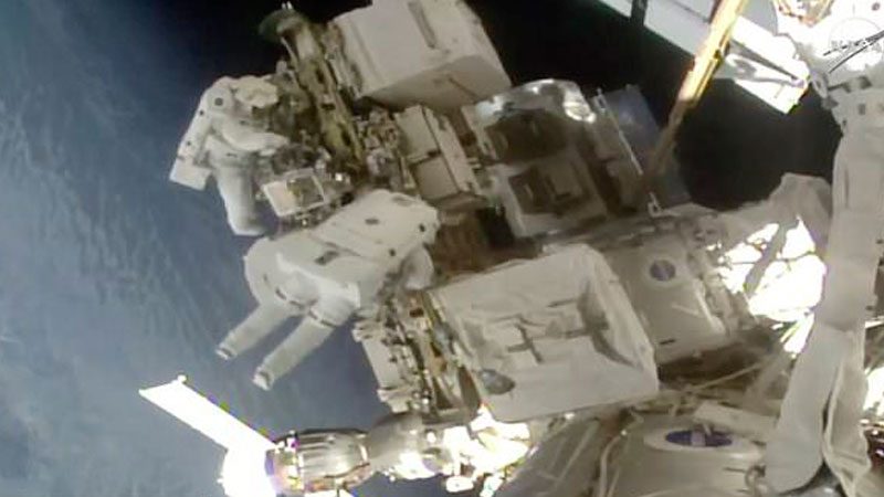 Spacewalking astronauts replace more station batteries