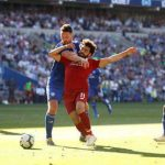 Liverpool back on top after 2-0 win at Cardiff
