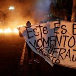 Anti-riot police step back from Honduras protests, fueling demonstrations