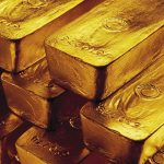 Gold drops on profit-taking; set for third weekly rise