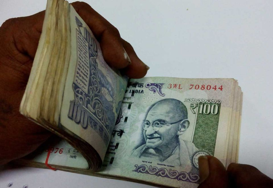Indian rupee opens down against the dollar