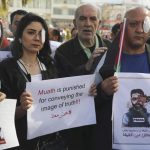 Palestinian journalists protest wounding of colleague