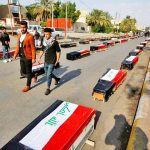 With sorrow and anger, clans mourn kin gunned down on bridge in southern Iraq