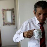 Backstory: As a riot rages, a smartly-dressed Chilean sips his soda