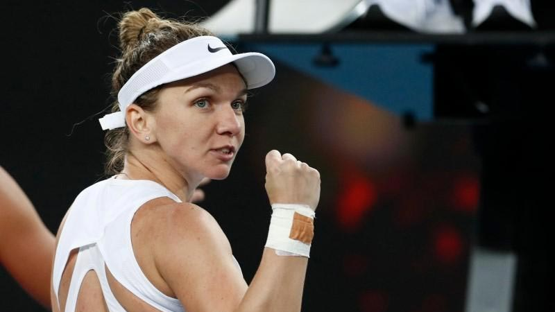 Halep survives injury scare in tough first-round win
