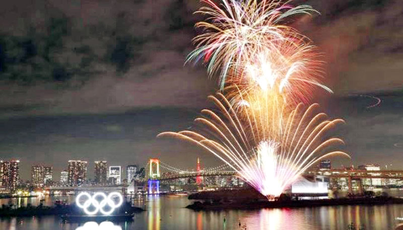 Tokyo celebrates with fireworks show to mark six months before Olympics