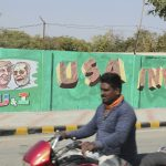 India builds wall along slum ahead of Trump visit
