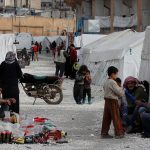 Turkey says will not stop Syrian refugees reaching Europe after troops killed