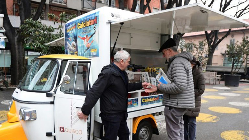 Italy's three-wheeled newsagent revs up against crisis