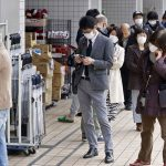 Tokyo restricts movement to combat virus, some folk carry on as usual
