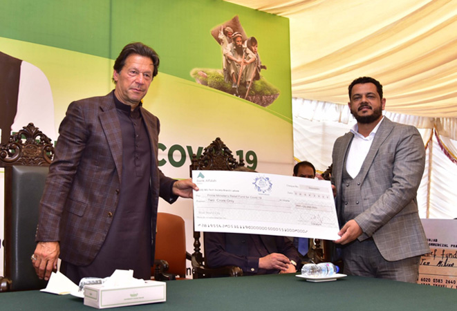 Blue World City CEO Saad Nazeer presents cheque of donation to PM