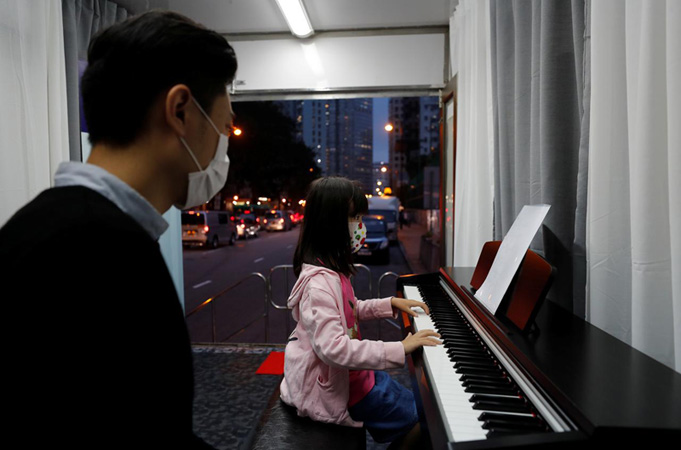 Hong Kong music school keeps on trucking through COVID shutdown