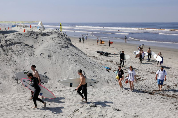 Beach crowds lead California to increase health warnings