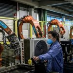 China's factory activity rebounds but threat from virus looms