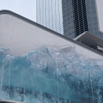 World's Biggest Virtual Wave Crashes Against Glass In Optical Illusion