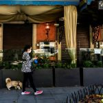 Italy's restaurants, shops caught between rock and hard place