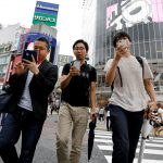 Japan bans mobile phone usage while walking on road
