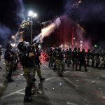 Serbia arrests 71 over virus protest violence, including Briton