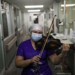 Strains of hope: Chilean nurse serenades COVID-19 patients with violin