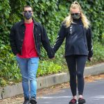 Sophie Turner cradles her baby bump on stroll with Joe Jonas