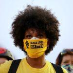 Black activists praise Biden's pick of Harris, but warn challenges remain