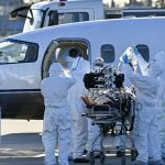 Europe faces tougher virus curbs as global cases hit daily record