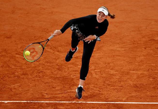 Former French Open champion Ostapenko upsets No. 2 seed Pliskova