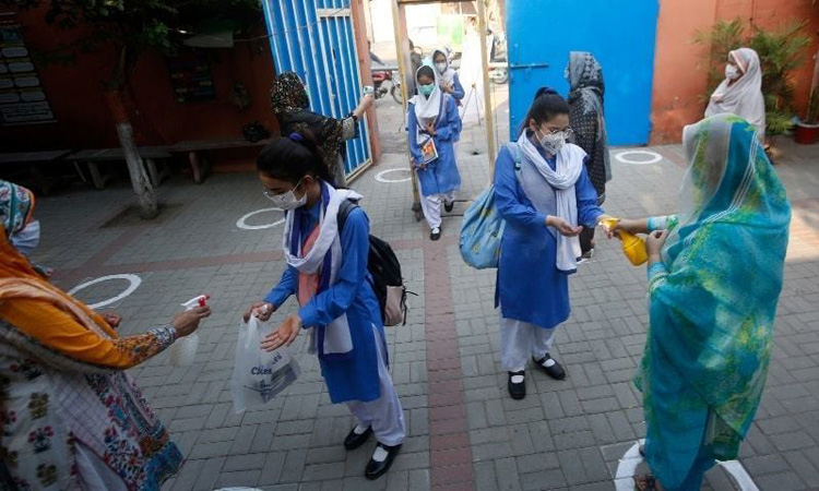 """ISLAMABAD: A large number of parents have demanded of the concerned authorities to announce summer vacations for the students, especially early years whose health is at risk due to the scorching heat and prolonged exposure to high temperatures within the classrooms, lacking facility of cooling and clean drinking water. It has been observed that several students have lost consciousness in different schools of Islamabad while many were unable to attend schools due to the unbearable heat. Many of the small kids feel the heat and feel sick in their classrooms. Parents are asked to rush to school and take their kids to a medical facility for first-aid. A female teacher at Islamabad College for Girls F-6/2 on the condition of anonymity said, """"In this hot weather, children are at greater risk than adults for dehydration and heat illness. Nausea, vomiting, diarrhea, loss of consciousness and headache is commonly seen among the students these days."""" She further said that the high officials of the Federal Directorate of Education (FDE) and principals of the educational institutions sitting in the air-conditioned rooms cannot be aware of how difficult it is for the students as well as the teachers to manage academic routine in the burning heat of summer. """"Fighting the heat itself is a hard challenge for small kids and what can be said about the exams"""". Asad, a student of H-8 College said, """"It's awfully hot in our college and I start sweating when I am just sitting in my class. Ceiling fans of the classrooms are very old and they move slowly. The suffocating heat in classrooms makes even the simplest tasks difficult. Water coolers are out of order. There is no cold drinking water available nearby. We have to go to the main gate to drink even a sip of water. Many teachers complained that FDE and educational institutions are working on contradictory promotion policies. On the one hand it was announced in the media that students of class I to IV and Class VI to VII will be promote"""