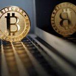 Bitcoin skids to $33,970 as cryptos show mixed trends