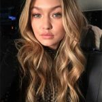 Gigi debuts red hair as she returns to the runway six months after giving birth
