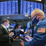 Dow ends above 35,000 for first time as US stocks hit records