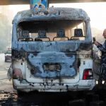 Explosion flares up army bus in Damascus, 13 killed